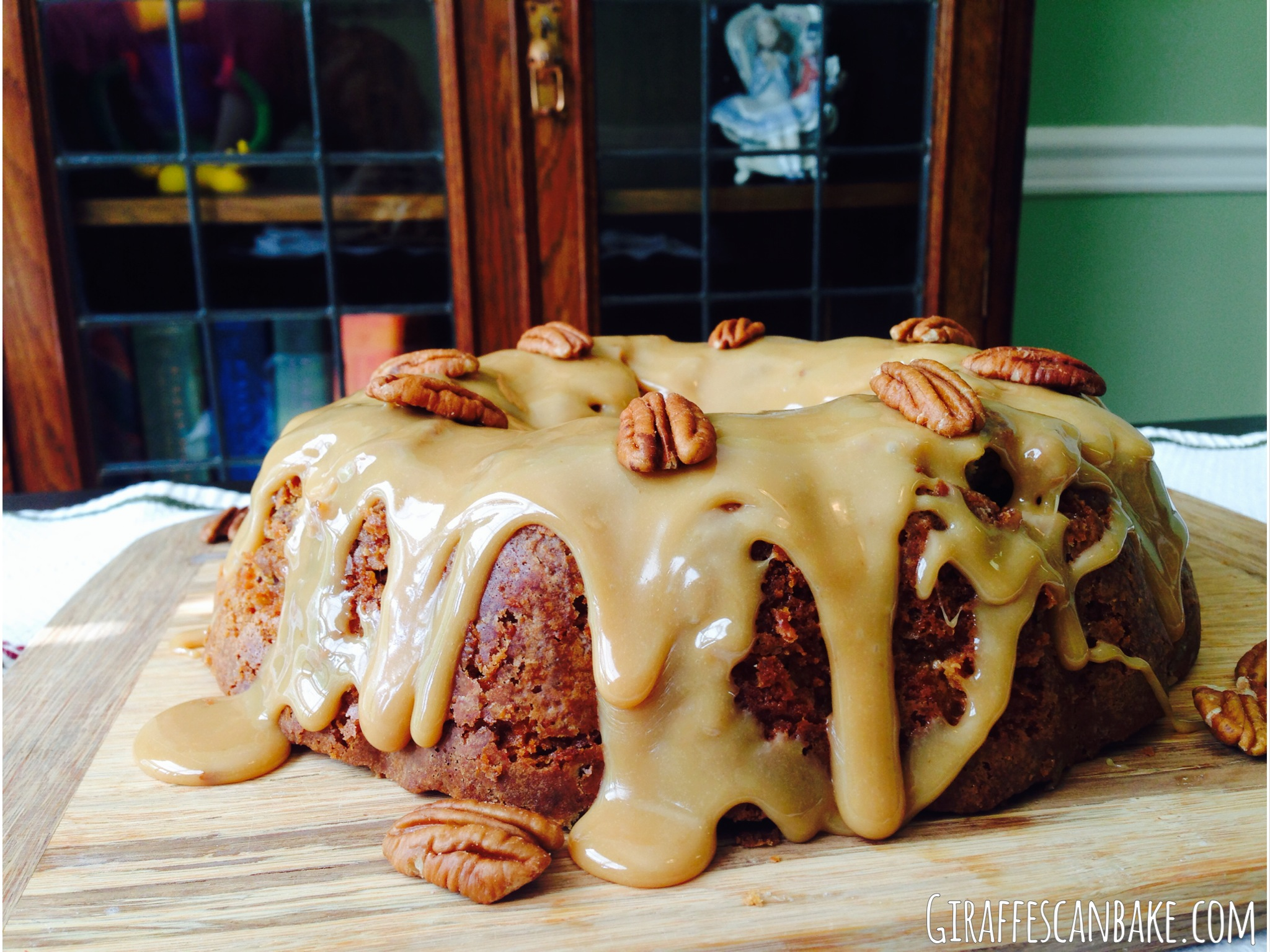 Brown Sugar and Pecan Caramel Bundt Cake - a moist and tender bundt cake stuffed full of pecans and toffee, smothered with thick caramel and topped with pecans!