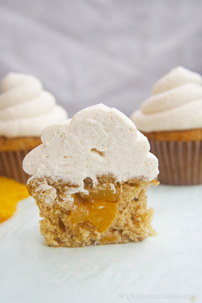 Peach Cupcakes with Cinnamon Frosting by Giraffes Can Bake - Moist peach cupcakes with a spiced peach filling, topped with a creamy and delicious Cinnamon frosting. You can used canned peaches, so you can enjoy these amazing cupcakes all year round!