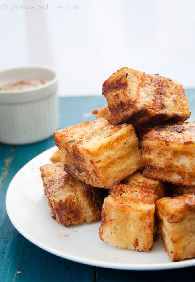 Peanut Butter & Jelly French Toast Bites with Balsamic Dipping Sauce - Delicious brioche french toast stuffed with peanut butter and strawberry jam, in bite size pieces! Plus an amazing balsamic dip to really take this awesome breakfast to the next level! It's an easy, yet impressive breakfast that everybody will love!